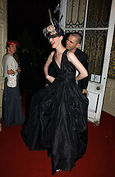 Model ERIN O'CONNOR and ROLAND MOURET at the 2006 Moet & Chandon Fashion Tribute in honour of photographer Nick Knight, held at Strawberry Hill House, Twickenham, Middlesex on 24th October 2006.<br />