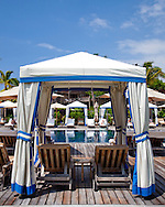 The Four Seasons Resort Hualalai at Historic Kaupulehu on the Big Island of Hawaii. Cabanas line the Beach Tree Pool.