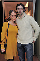 MIRANDA RAISON and RALF LITTLE at a party to celebrate the announcement of the 20 shortlisted designers for the UK final of the Triumph Inspiration Award 2011 held at the home of Charlotte Stockdale, 8 Francis Street, London SW1 on 31st March 2011.