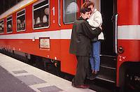 couple saying goodbye at a train station