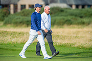 Rory McIlroy and his father Gerry McIlroy walk up the 17th fairway together during the third round of the Alfred Dunhill Links Championship European Tour at St Andrews, West Sands, Scotland on 28 September 2019.
