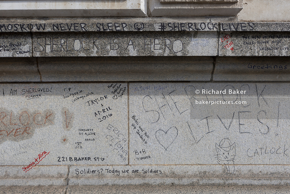 Graffiti scrawled on the exteriour of Barts Hospital, by fans of the popular TV show Sherlock starring Benedict Cumberbatch where the fictional character was filmed, seemingly jumping to his death, on 5th March 2017, at Smithfield, in the City of London, England.