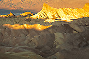 Early light illuminates the rock formations of Golden Canyon. Taken from Zabriskie Point, Death Valley National Park, California