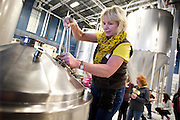 Participant Thairn Telindert gives the mash a stir during Women's Brew Day at Wisconsin Brewing Company in Verona, Saturday, January 24, 2015. The day was filled with education for female brewers from female beer industry experts, discussing malt, hops, beer styles and beer distribution.