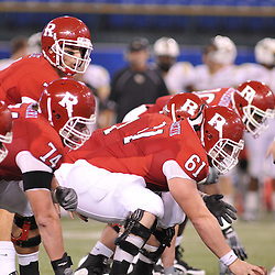 Dec 19, 2009; St. Petersburg, Fla., USA; Rutgers quarterback Tom Savage (7) lines up under center Ryan Blaszczyk (61) during NCAA Football action in Rutgers' 45-24 victory over Central Florida in the St. Petersburg Bowl at Tropicana Field.