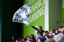 A Bristol Bears supporter in the crowd waves a flag in support - Mandatory byline: Patrick Khachfe/JMP - 07966 386802 - 27/04/2019 - RUGBY UNION - Welford Road - Leicester, England - Leicester Tigers v Bristol Bears - Gallagher Premiership Rugby