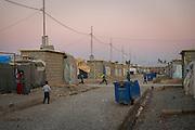 Children play inside Baharka camp