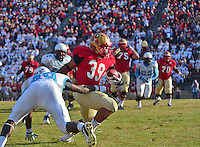 NCAA FCS: The Citadel holds on to edge VMI in the Military Classic of the South, 27-24 - VMI back Derrick Ziglar sheds a Citadel tackler during VMI's first touchdown drive of their second-falf rally against The Citadel on Saturday in Lexington.