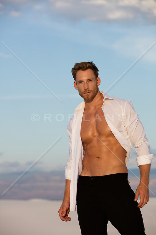 good looking All American man with an open shirt outdoors