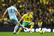 Picture by Paul Chesterton/Focus Images Ltd.  07904 640267.03/12/11.Andrew Crofts of Norwich and Gareth Barry of Man City in action during the Barclays Premier League match at the Etihad Stadium, Manchester.