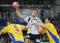 Handball EM Herren 2010 Vorrunde Deutschland - Schweden 22.01.2010 Michael Kraus (GER Mitte) gegen die Schweden Jonas Kaelman (links) und Tobias Karlsson (rechts)