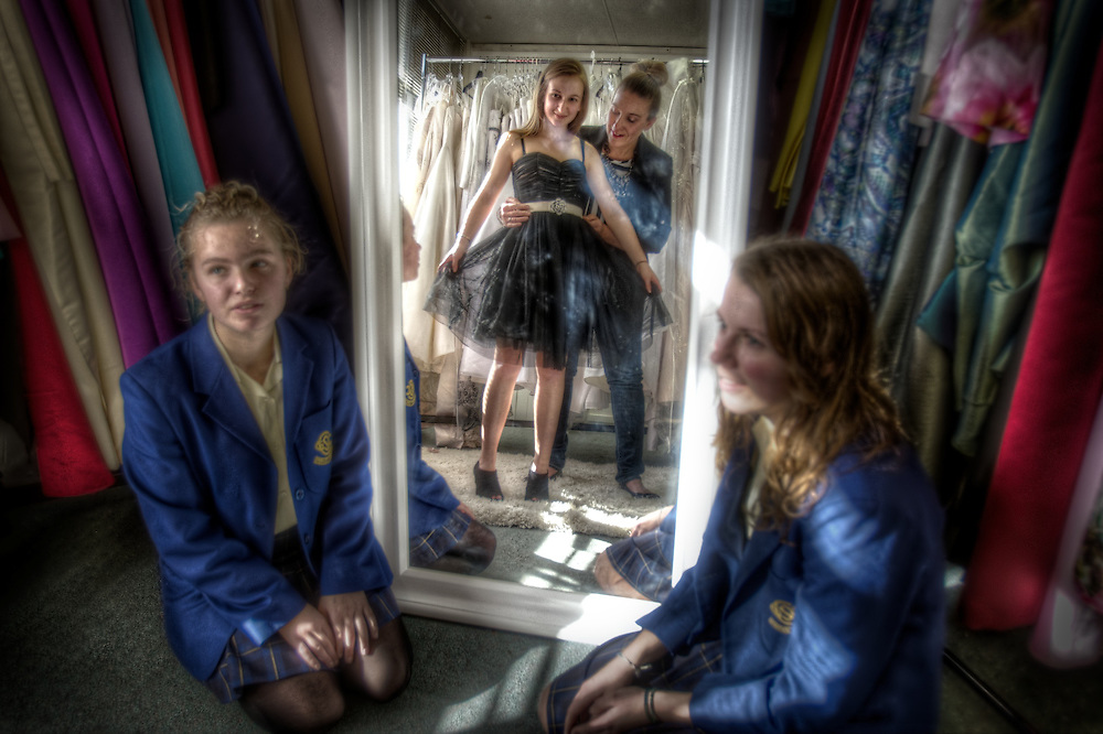 Amanda Stoke loans formal wear dresses to school girls, in dress is Magda Celjewsa 17yrs, watching on are friends left Iva Giusti 19 and Emily Payne 18. Pic By Craig Sillitoe CSZ/The Sunday Age.3/8/2011 melbourne photographers, commercial photographers, industrial photographers, corporate photographer, architectural photographers, This photograph can be used for non commercial uses with attribution. Credit: Craig Sillitoe Photography / http://www.csillitoe.com<br />
