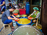 03 FEBRUARY 2019 - BANGKOK, THAILAND: Workers sort cooked soybeans in a workshop in Bangkok's Chinatown district. The soybeans will be used to make desserts and snacks for Chinese New Year. Chinese New Year celebrations in Bangkok start on February 4, 2019. The coming year will be the Year of the Pig in the Chinese zodiac. About 14% of Thais are of Chinese ancestry and Lunar New Year, also called Chinese New Year or Tet is widely celebrated in Chinese communities in Thailand.     PHOTO BY JACK KURTZ
