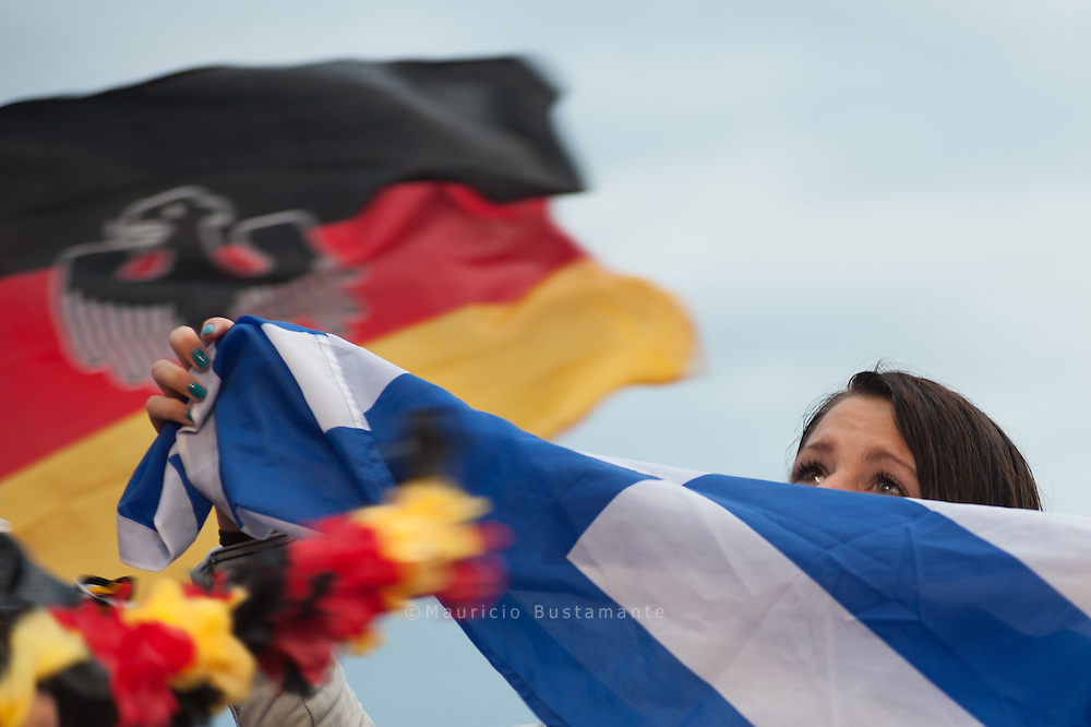 Germany overpower Greece in Gdansk. Hamburg fans troop to the public viewing park in Hamburg, to watch their team fight it out in the quarterfinals. Germany outclassed Greece with a final score of 4-2. Germany.  A fan of the German soccer team was surrounded by supporters of the German soccer team at a public viewing event in Hamburg showing the Euro 2012 match between Germany and Greece.