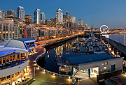 WA15327-00...WASHINGTON - Night settling over the Seattle Waterfront from Pier 66, including the Bell Harbor marina, the Great Wheel, Coleman Dock, hghrises,the stadiums, the Port of Seattle and the Smith Tower.