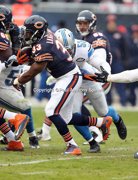 Chicago Bears rookie running back Jeremy Langford (33) tries to break a tackle attempt by Detroit Lions outside linebacker Kyle Van Noy (53) during the NFL week 17 regular season football game against the Detroit Lions on Sunday, Jan. 3, 2016 in Chicago. The Lions won the game 24-20. (©Paul Anthony Spinelli)