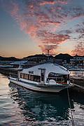 Boats in Nachikatsuura harbor at sunset, Kii Peninsula, Wakayama Prefecture, Japan.