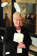 Mary Pat Golden of Miamisburg stands ready to hand out programs before a performance of 'The Way of the Cross' at St. Luke Catholic Parish in Beavercreek, Friday, March 30, 2012.