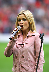 LIVERPOOL, ENGLAND - SUNDAY MARCH 27th 2005: Welsh mezzo-soprano classical singer Katherine Jenkins performs before the Liverpool Legends v Celebrity XI Tsunami Soccer Aid match at Anfield. (Pic by David Rawcliffe/Propaganda)