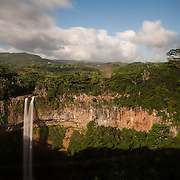 The Chamarel falls in Black River, Mauritius. This waterfall is a popular destination for tourists on day trips.