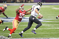 3 February 2013: Quarterback (5) Joe Flacco of the Baltimore Ravens runs away from (55) Ahmad Brooks of the San Francisco 49ers during the first half of the Ravens 34-31 victory over the 49ers in Superbowl XLVII at the Mercedes-Benz Superdome in New Orleans, LA.