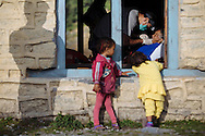 Children watch as Dr. Aayush Kharel of Kathmandu performs a tooth extraction at a medical camp in Tilche, in the Manang District in northern Nepal.