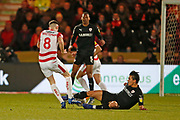 Barnsley midfielder Kenny Dougall (4) is injured in a tackle with Ben Whiteman of Doncaster during the EFL Sky Bet League 1 match between Doncaster Rovers and Barnsley at the Keepmoat Stadium, Doncaster, England on 15 March 2019.