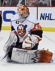 Apr 10, 2010; Newark, NJ, USA; New York Islanders goalie Martin Biron (43) makes a save during the third period at the Prudential Center. The Devils defeated the Islanders 7-1.