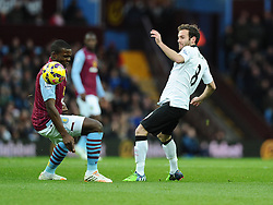 Manchester United's Juan Mata flicks the ball over Aston Villa's Jores Okore  - Photo mandatory by-line: Joe Meredith/JMP - Mobile: 07966 386802 - 20/12/2014 - SPORT - football - Birmingham - Villa Park - Aston Villa v Manchester United - Barclays Premier League