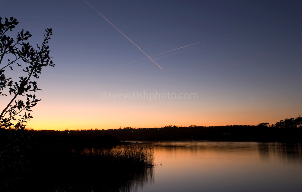 The River Slaney, Wexford, seen from Crossabeg, above, Killurn Bridge. Contrails from airliners crossing overhead