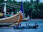 29 JULY 2017 - AIRKUNING, BALI, INDONESIA: A tender brings supplies to a small trawler in Kuning, a Muslim fishing village on the southwest corner of Bali. A lot of the fishing is done from small outrigger canoes that stay out overnight. Villagers said their regular catch of fish has been diminishing for several years, and that are some mornings that they come back to shore with having caught any fish.    PHOTO BY JACK KURTZ