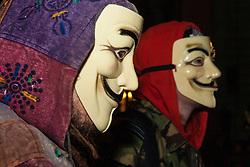 """London, December 23rd 2014. Online activism group Anonymous march through London from the City to the BBC's HQ on Great Portland Street in protest against alleged biases and coverups of a """"paedophile ring"""". PICTURED: Protesters wear their Guido Fawkes masks, long associated with Anonymous and anti-establishment activism."""
