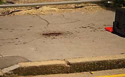 ©Licensed to London News Pictures 17/06/2020<br /> Croydon, UK. Blood on the pavement. A man in his twenties is fight for his life in hospital tonight after being stabbed in Croydon, South East London. Police and paramedics were called at 7.45pm. Police are on scene and a cordon is in place. Photo credit: Grant Falvey/LNP