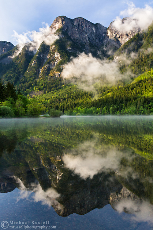 Wells Peak is reflected in Silver Lake after a storm - Silver Lake Provincial Park.