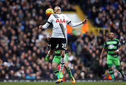 Dele Alli of Tottenham Hotspur heads the ball - Mandatory byline: Robbie Stephenson/JMP - 28/02/2016 - FOOTBALL - White Hart Lane - Tottenham, England - Tottenham Hotspur v Swansea City - Barclays Premier League