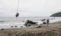 Mystic Beach on the Juan de Fuca Trail on the West Coast of Vancouver Island features steep rock walls, a seasonal waterfall and a rope swing for fun.