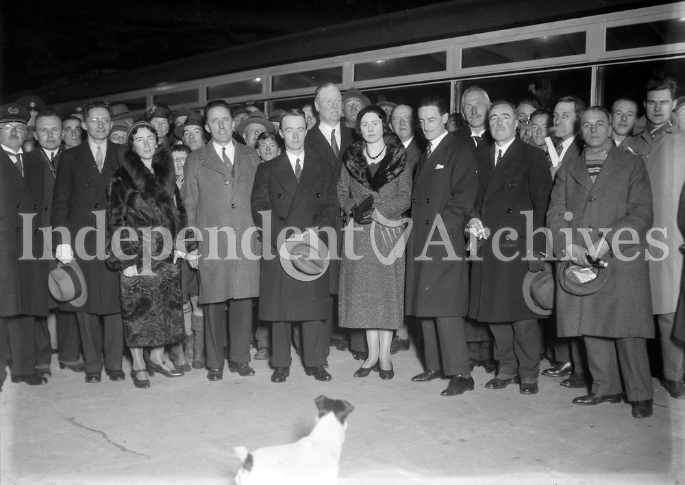 H1684 The Drumm Train. Passengers on the arrival of the Drumm battery train, at Bray, following its first demonstration run on 1st December 1931. Incl. L-R: J.J. McElligott (Secretary Dept. of Finance and Chairman of Celia Ltd.), Mrs Nolan, J.M. Fay and J.J. Drumm (Joint Managing Directors of Celia Ltd.), Prof. J.J. Nolan, Mrs Drumm, P. McGilligan (Minister for Industry and Commerce), Prof. J. A. Taylor, W.H. Morton (Chief Mechanical Engineer, Great Southern Railways), and W.Storey (Electrical Engineer, GSR) <br /> <br /> (Part of the Independent Ireland Newspapers/NLI Collection)