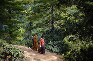 Paro, Bhutan. Two women returning from the monastery of Taktshang.