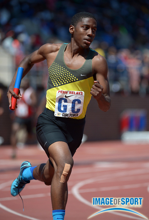 Apr 26, 2014; Philadelphia, PA, USA; Chris Polk runs the anchor leg on the Long Beach Poly 4 x 400m relay that placed third in its heat in 3:16.89 in the 120th Penn Relays at Franklin Field.