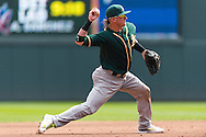 Josh Donaldson #20 of the Oakland Athletics makes a throw to 1st base against the Minnesota Twins on April 9, 2014 at Target Field in Minneapolis, Minnesota.  The Athletics defeated the Twins 7 to 4.  Photo by Ben Krause