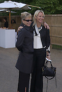 Kay Saatchi and Amanda Elliasch. Serpentine Gallery Summer party in a glass and steel pavilion designed by Toyo Ito and Arup. . tuesday 9 July 2002. © Copyright Photograph by Dafydd Jones 66 Stockwell Park Rd. London SW9 0DA Tel 020 7733 0108 www.dafjones.com
