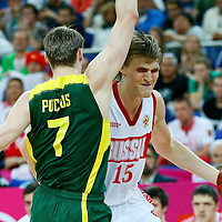 08 August 2012: Russia Andrei Kirilenko drives past Martynas Pocius during 83-74 Team Russia victory over Team Lithuania, during the men's basketball quarter-finals, at the 02 Arena, in London, Great Britain.