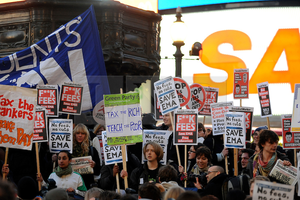 © London News Pictures. 2011/01/19 Students at Piccadilly Circus. A rally and march in central London, UK, today (Wed) held by students on the day MPs are to vote on a Labour call for a rethink of the government's decision to scrap the Education Maintenance Allowance for low-income students. Picture credit should read Stephen Simpson/LNP