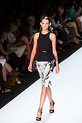 White, black and gray print knee-length shorts with a black sleeveless top with a flared hem. By Monique Lhuillier at Spring 2013 Fall Fashion Week in New York.