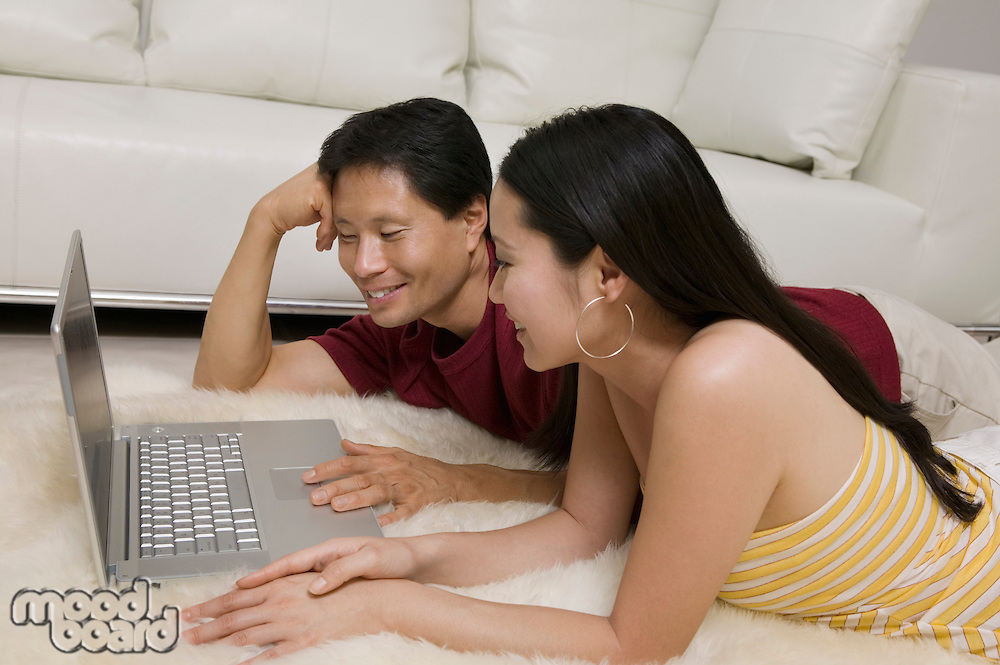 Couple on Rug Using Laptop