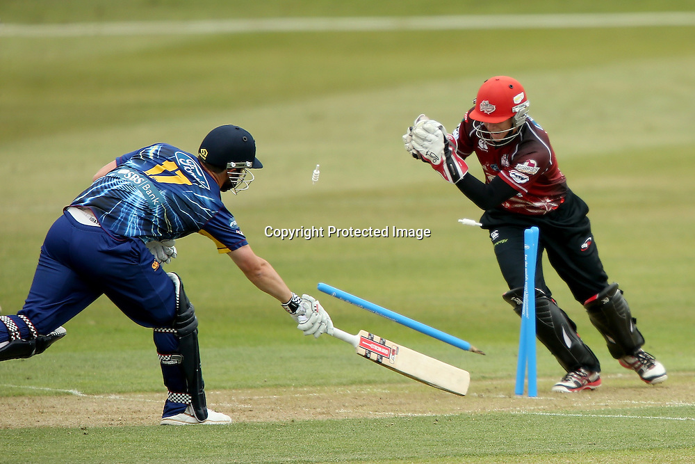Canterbury's Tom Latham runs out Otago's Hamish Rutherford during the HRV Cup Twenty20 Cricket match between Canterbury Wizards and Otago Volts at Aorangi Oval, Timaru on Thursday 27 December 2012. Photo: Martin Hunter/Photosport.co.nz