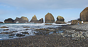 Sea stack rocks in the Pacific Ocean, on the north side of the hiker's tunnel at Oceanside beach, Oregon, USA