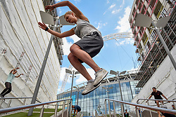 © Licensed to London News Pictures. 19/08/2018. LONDON, UK.  A parkour practitioner takes part in the Rendezvous International Parkour Gathering XIII 2018 at Wembley Park.  The three day training event, organised by Parkour Generations, brings some of the world's best parkour and free running teachers to the UK to lead a series of workshops for parkour enthusiasts.  Photo credit: Stephen Chung/LNP