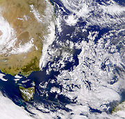 Satellite photograph of the Tasman Sea partially covered by cloud. On left is part of Australia with Tasmania below it. NASA. Science
