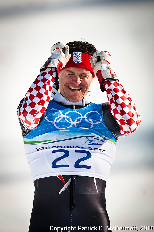 Silver medalist Ivica Kostelic, CRO, celebrates during the flower presentation after the Men's Super Combined during the 2010 Vancouver Winter Olympics in Whistler, British Columbia, Sunday, Feb. 21, 2010.